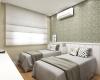 quarto de hospedes com papel de parede verde e cabeceira da cama em mdf