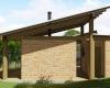 vista lateral casa de tijolinho e madeira
