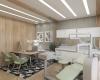 area interna do consultório de dentista com acabamentos em madeira e detalhes em tecido na cor verde clara