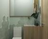 lavabo do consultorio com acabamentos em tons esverdiados