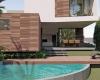 vista da piscina e area gourmet com bastante concreto e madeira cumaru condominio brisas da mata em jundiai