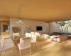 vista da sala de jantar e da sala de estar acabamentos em madeira residência térrea em Brasília