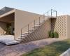 Vista lateral da escada em concreto de casa contemporânea em Brasília