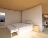 dormitório acabamentos em madeira e integração com os ambientes sociais
