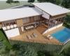 vista aérea de casa em estrutura metalica em terreno com declive acentuado