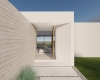 vista da porta de entrada de casa contemporânea com paredes em concreto ripado aparente e masa branca, porta em madeira, casa em jundiaí